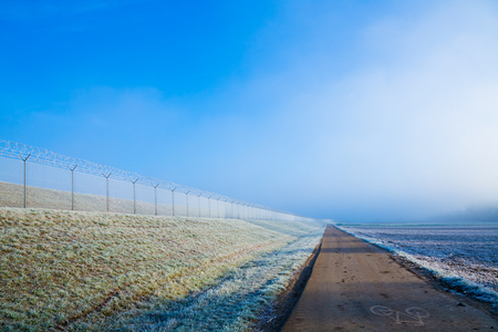 demarcation: Long border fence in the morning