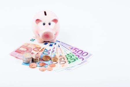 piggy bank with bills and coins in euro