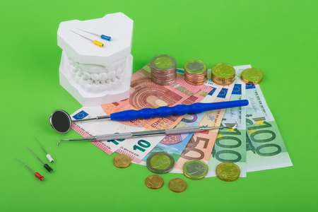teeth and tools, and money for dentist Stock Photo