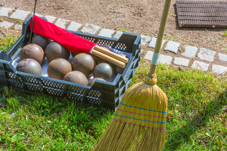 shot put spheres and red flag with broom in athletics