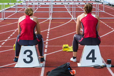 two athletes waiting for their race in hurdles Stock Photo