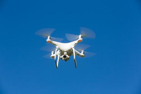 Drone flies in the blue sky
