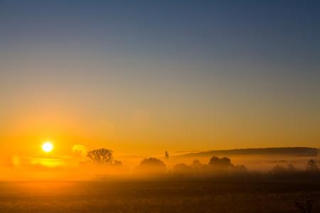 colorful sunrise on a misty morning