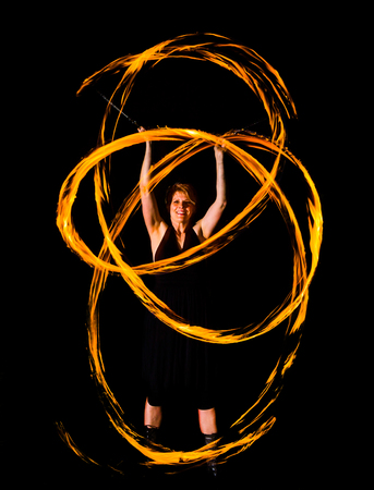 woman shows rings of fire in the night