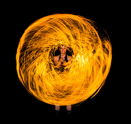 fire donut in the night in a performance with fire