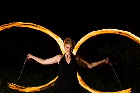 woman shows middle age performance with torches Stock fotó