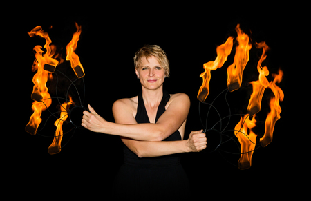 woman performs fire show with torches