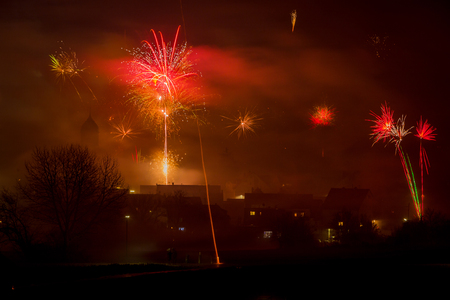 fireworks on new years eve 2019 with colorful rockets in the sky Standard-Bild - 116771291