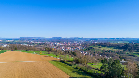 aerial with view to the suabian alb and the city Nuertingen Standard-Bild - 116772574