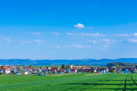 idyllic village Wolfschlugen in Germany with view to the suabian alb Standard-Bild - 116772673