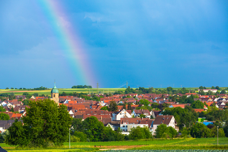 idyllic view to a village with rainbow Standard-Bild - 116772688