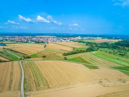 aerial view over fields towards village Wolfschlugen in Germany Standard-Bild - 116772734