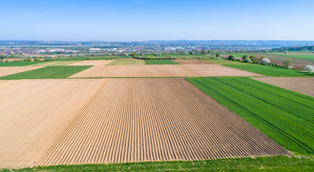 aerial with view to empty fields in the spring