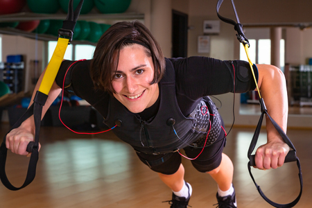 young woman smiling during her work out with bands Banco de Imagens