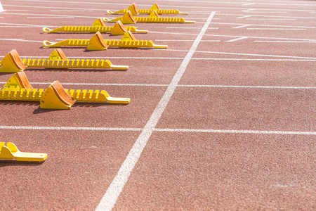 start line in athletic stadium with copy space Banco de Imagens