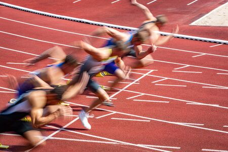 blurred start of athletic runners in sprint Stock Photo
