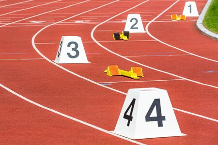 tracks and numbers in stadium for 400 m run
