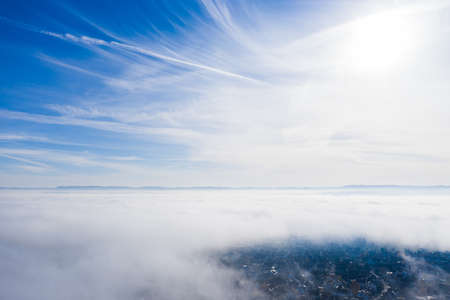 aerial of the sky, high fog and the swabian alp in the background
