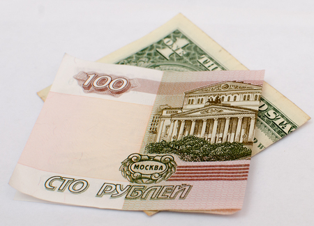 rubles and dollars on a white background. Stock Photo