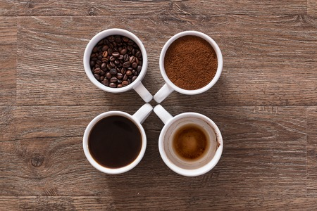cup four: Four cups of coffee, phases of drink - bean, ground and empty cup