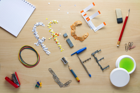 daily routine: Office life inscription on a wooden desk laid out of stationery. Clerks weekdays. Daily routine