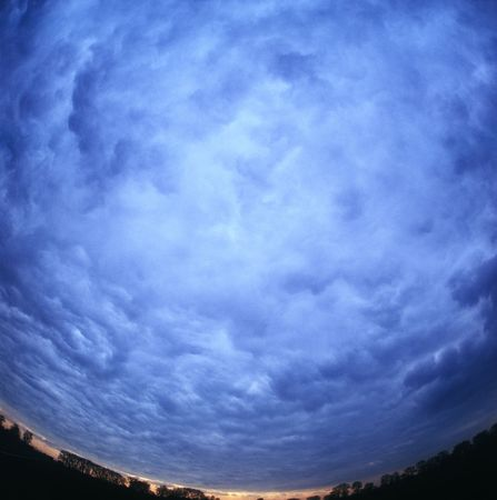 Dramatic sky view through the super wide angle lens. Stock Photo