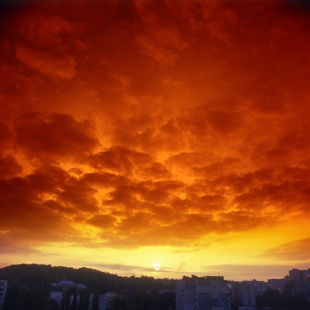 Ominous crimson sunset over a sity. Please see some similar pictures from my portfolio. Stock Photo - 8571308