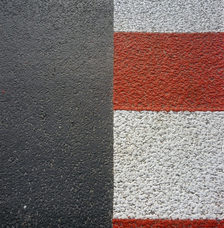 Red - white road marking on a pedestrian crossing. Please see similar photos in my portfolio. photo