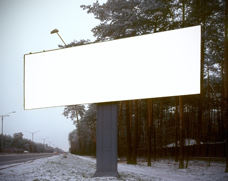advertising board: Blank advertising board on a roadside. Stock Photo