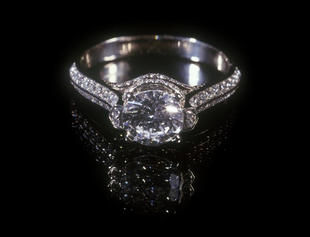 White gold diamond ring isolated on black background. Archivio Fotografico