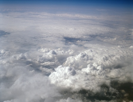 firmament: Kind on clouds on a background a firmament from an airplane.