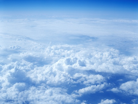Clouds from above, taken from an airplane. photo