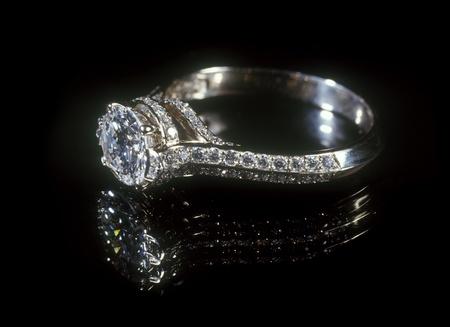 White gold diamond ring isolated on black background. Stock Photo