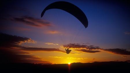 Paraglider flying against a sunset. Crimea, Ukraine. photo