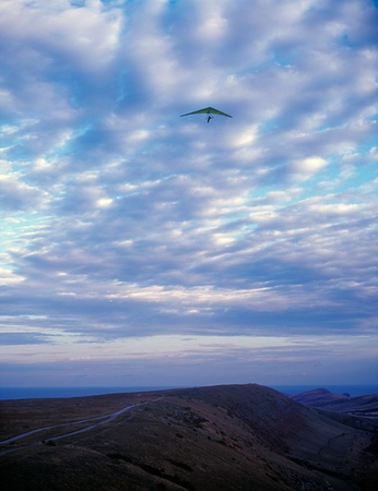 Hang glider under clouds. Clementyev mountain, Crimea, Ukraine. photo