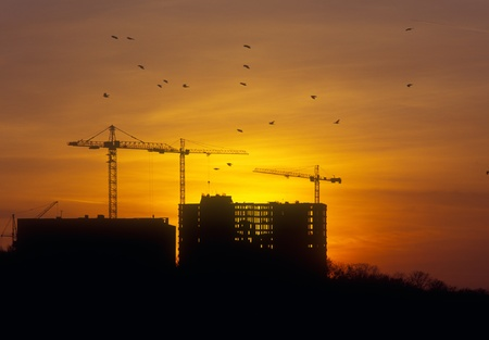 Sunset at the construction site. Please see similar images in my portfolio. photo