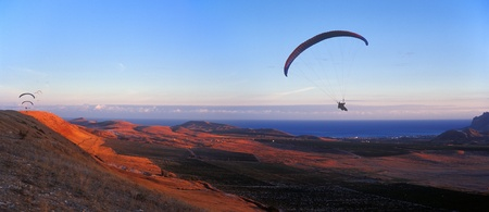 hovering: Paragliders flying against a sunset. Crimea, Ukraine.