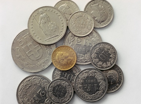 Various swiss franc coins on a white background. Archivio Fotografico