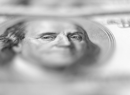 $100 banknote background with extremely shallow depth of field. Focus on eyes.