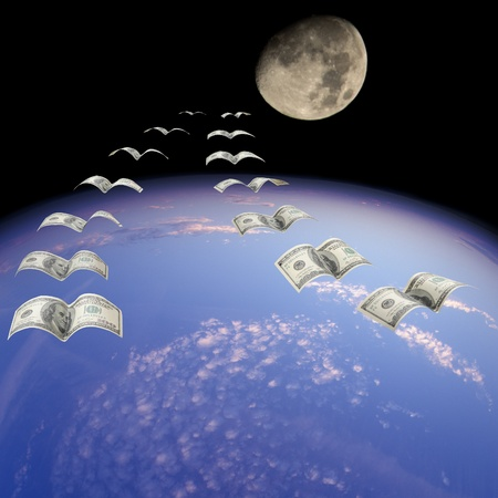A flock of $100 banknotes in flight. photo