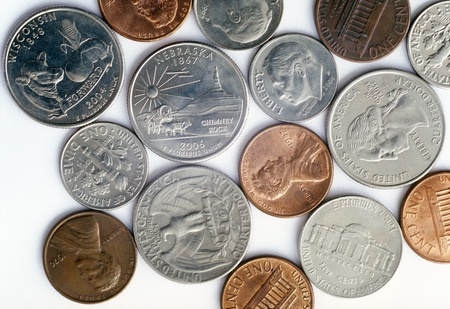 dime: Various US coins on the white background.