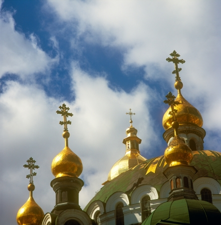 Golden cupola of Kiev-Pechersk Lavra. Kiev-Pechersk Lavra is a famous ancient orthodox monastery. Kyiv, Ukraine. photo