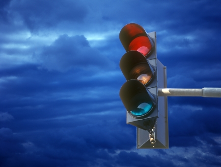 Traffic light  against the blue cloudy sky. photo