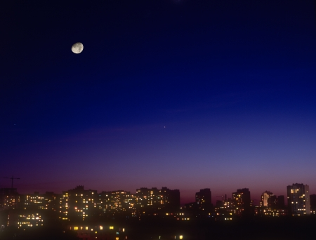 violet residential: Night cityscape with moon. Residential district of Kyiv, Ukraine.