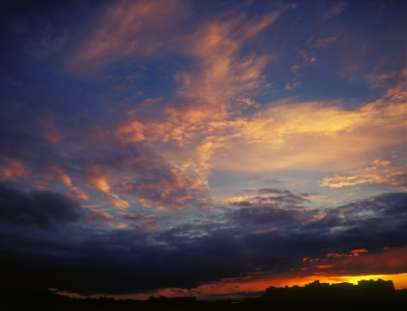 The magnificent sky and clouds in last beams of the sun. Stock Photo