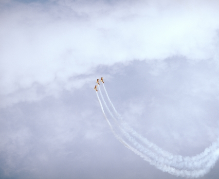 Sport aircrafts with white smoke trails during air\ show.