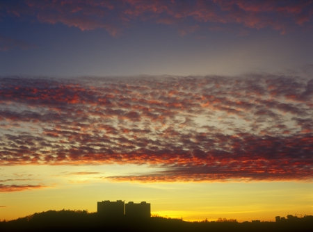 Beautiful multicolored sunset over a dark cityscape  Stock Photo