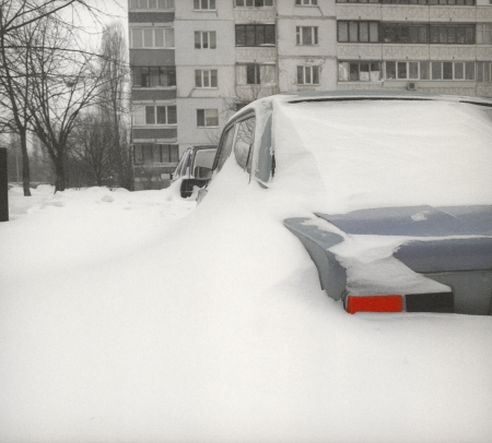 snowbank: After snowstorm in Kyiv with cars buried in snow