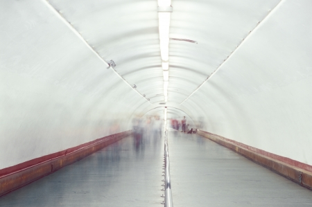Blurred and defocused people walking in the passage  Stock Photo