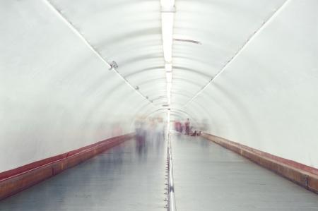 Blurred and defocused people walking in the passage  Standard-Bild